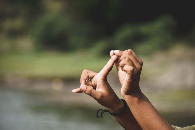 Cropped hands of person holding pebble