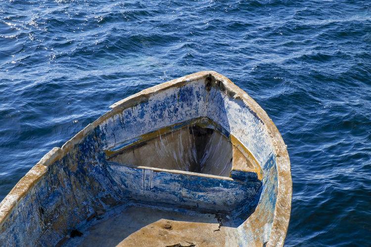 Abandoned boat on sea