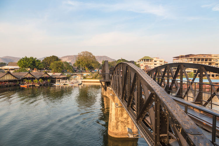 The famous River Kwai bridge in Kanchanaburi, Thailand. The bridge was part of the famous death railways that the Japanses tried to building between Burma and Thailand during WWII. Architecture Bridge - Man Made Structure Bridge Of River Kwai Building Exterior Built Structure Connection Day Kanchanaburi Kwai Landmark Nature No People Outdoors Railroad River Sky Thailand Water