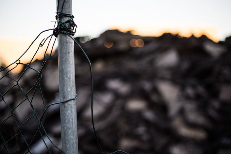 Close-up Dreck Fence Focus On Foreground No People Outdoors Sky Sunset Waste
