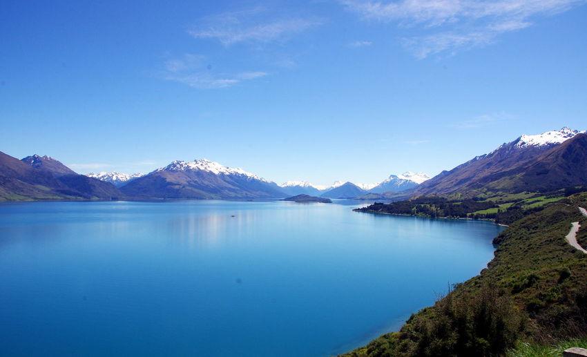 Calm Lake Against Mountain Ranges