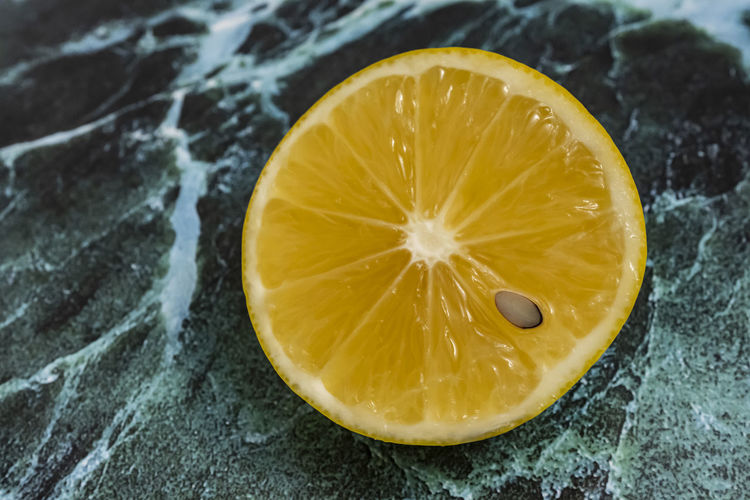 close up sliced lemon on floor Food Fruit Food And Drink Healthy Eating Citrus Fruit Freshness Wellbeing SLICE Close-up Yellow No People Lemon Cross Section Indoors  Still Life Juicy Halved High Angle View Table Focus On Foreground Ripe Orange
