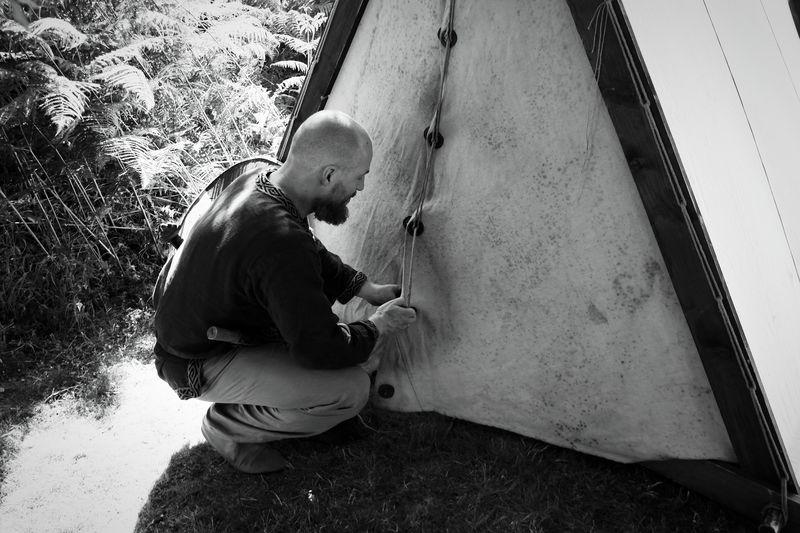 Man pitching tent
