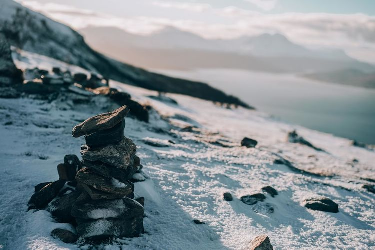 Stack of stones on snow covered land