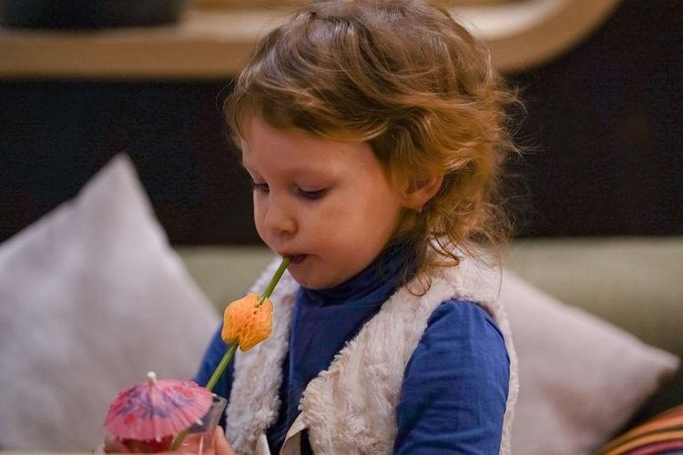 Cute girl having drink