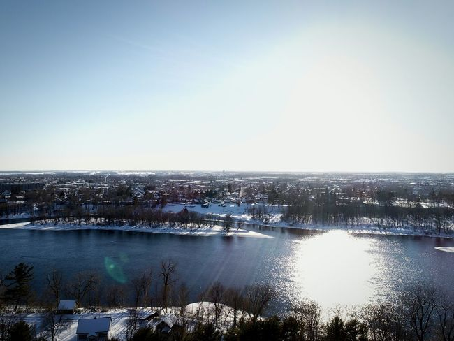 Water Horizon Over Water Outdoors Day Sky Cityscape Scenics Building Exterior Clear Sky City Sunlight Spring 2017 Architecture Blue Snow Winter Frozen Aerial View Cold Temperature Village Québecois D'antan Built Structure Shadow High Angle View Large Group Of People Lake