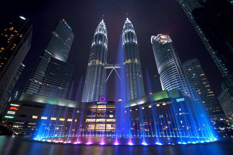 Low angle view of illuminated city at night