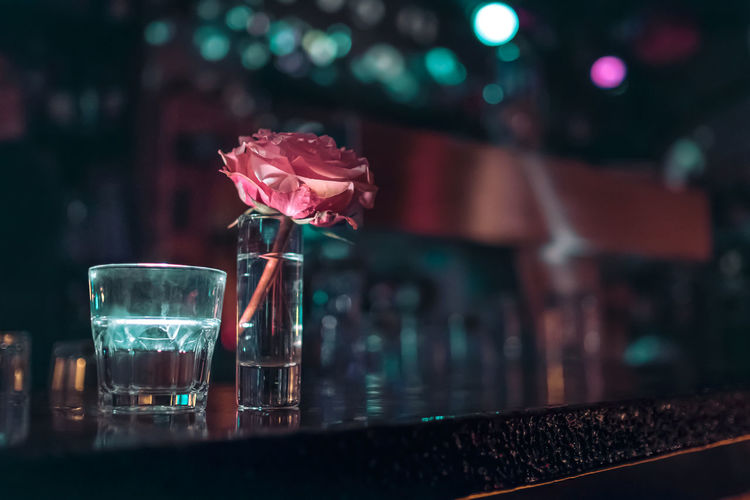 Copy Space Lighting Equipment Low Lighting Bar - Drink Establishment Bar Counter Close-up Decoration Drink Drinking Glass Flower Focus On Foreground Food And Drink Fragility Glass - Material Indoors  Lifestyles Night Nightlife No People Prenzlauer Berg Rose - Flower Shot Glass Table Vase