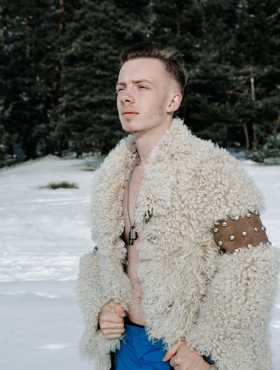 Fur Fur Coat One Person People One Man Only One Young Man Only Snow Cold Temperature Winter Portrait Handsome Standing Fashion Close-up Thoughtful Posing Snowcapped Winter Coat Warm Clothing Overcoat Redefining Menswear