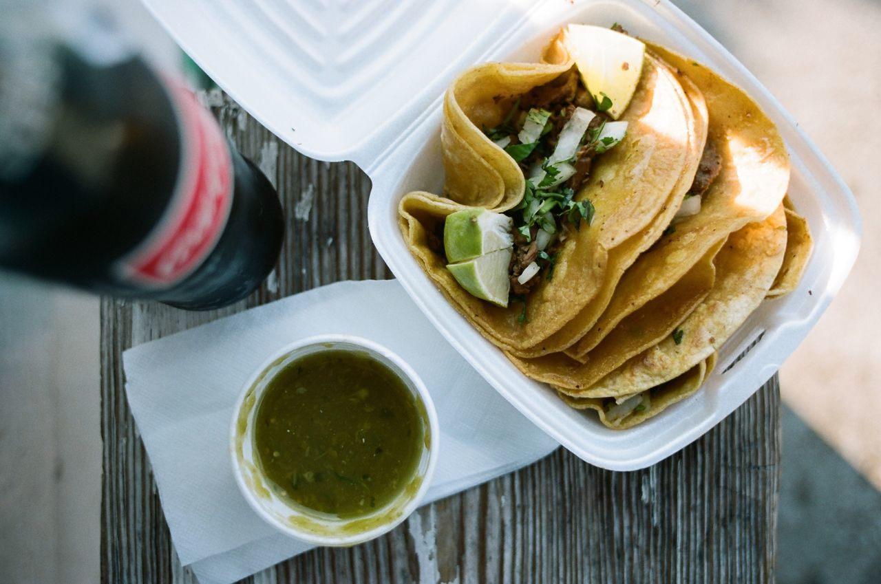 High angle view of tacos with cola served on seat