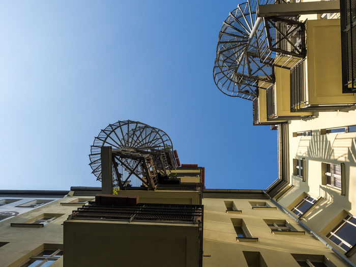Berlin Stairs Architecture Balcony Blue Building Building Exterior Built Structure Circular Circular Stairway City Clear Sky Copy Space Day Directly Below Low Angle View Metal Nature No People Outdoors Sky Staircase Sunlight