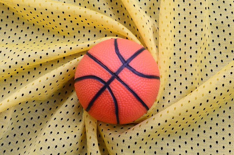 High angle view of basketball on fabric