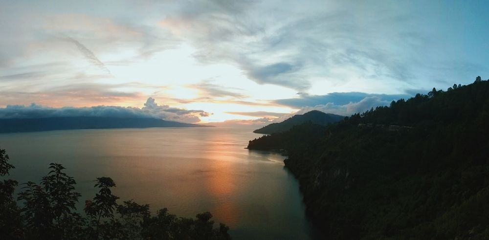 Sunset in Lake Toba Day Photography Lanscape Nature Beautiful View Vacation Relaxing History Place Fresh Trees Leaves Wonderful Place History Tree Mountain Water Sunset Dawn Sea Forest Silhouette Morning Sky Dramatic Sky Moody Sky Calm EyeEmNewHere