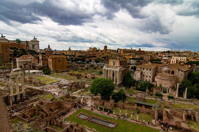 High angle view of roman ruins against cloudy sky