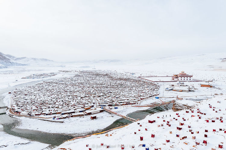 Yarchen Gar and the Nuns' Quarter in its entirety after snowfall. 03.03.10. A Journey To Nirvana China Documentary Documentary Photography Jun Michael Park Landscape Photojournalism Reportage Sichuan Snow Tibet Tibetan Buddhism Travel Travel Photography Winter Yarchen Gar