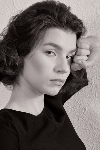 Close-up portrait of a teenage girl looking away