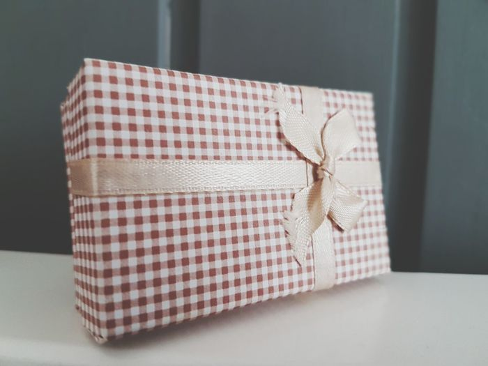 Close-up of wrapped gift box on table