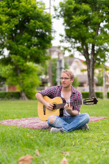 Man playing guitar in park