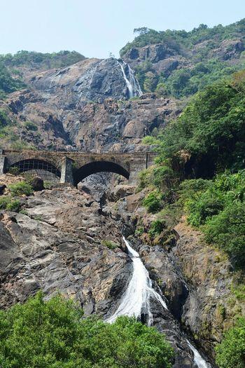 Arch bridge against mountain
