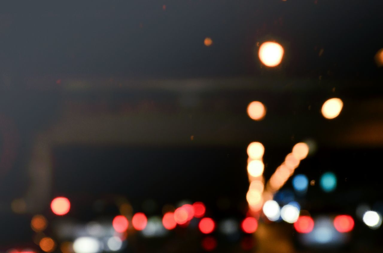 illuminated, night, defocused, lighting equipment, glowing, lens flare, no people, light effect, outdoors, close-up, multi colored, sky, city