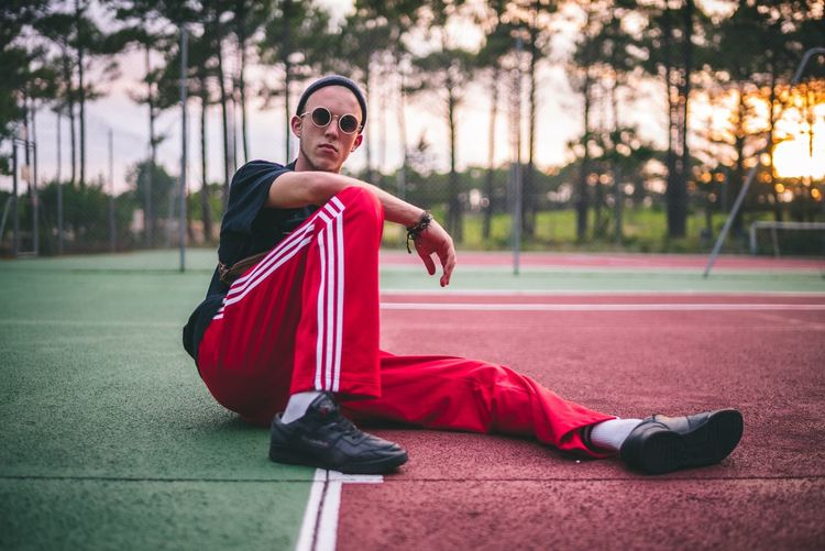 Modern Art Model Tenniscourt Red One Person Glasses Lifestyles Portrait Cape  Full Length Superhero Costume Sport Child Sunglasses Heroes Clothing Nature Real People Fashion Childhood