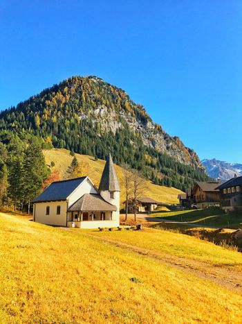 Built Structure Architecture Building Exterior House Mountain Country House Tranquil Scene No People Tranquility Blue Scenics Clear Sky Landscape Day Field Nature Grass Barn Outdoors Beauty In Nature