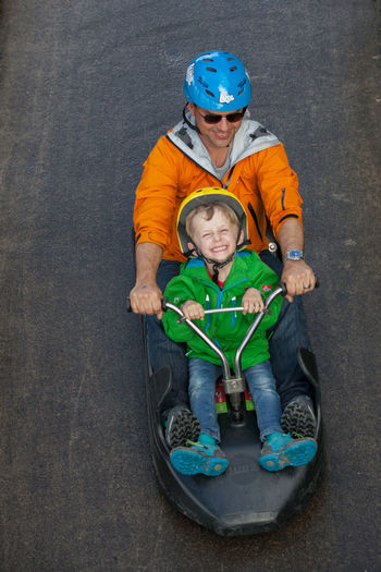 Bird Perspective Childhood Downhill Enjoyment Father And Son From Above  Fun Fun Happiness Helmet Leisure Activity Lifestyles Original Experiences Rotorua New Zealand Safety Speed The Luge On The Way Be Active People Together A Bird's Eye View Fatherhood Moments