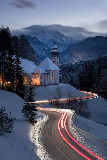 chapel in the bavarian alps Alpen Kirche Chapel Berchtesgaden Mariagern EyeEm Selects Mountain Winter Snow Religion Cold Temperature Nature Architecture Mountain Range Built Structure No People Spirituality Illuminated Place Of Worship Outdoors Beauty In Nature Travel Destinations Scenics Sky Night