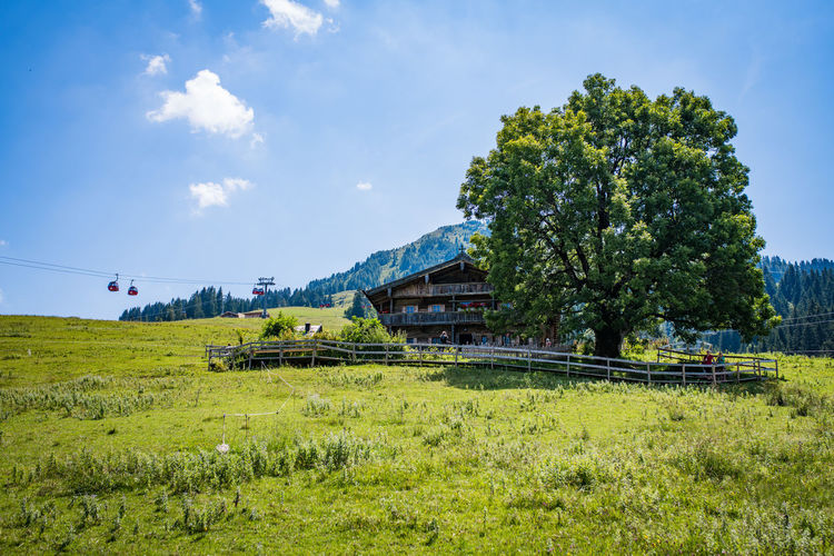 Mountain Hut Alpen Mountain Hut Plant Green Color Tree Land Sky Field Nature Grass Day Mode Of Transportation Environment Transportation Landscape Growth No People Scenics - Nature Cloud - Sky Beauty In Nature Land Vehicle Tranquil Scene Outdoors