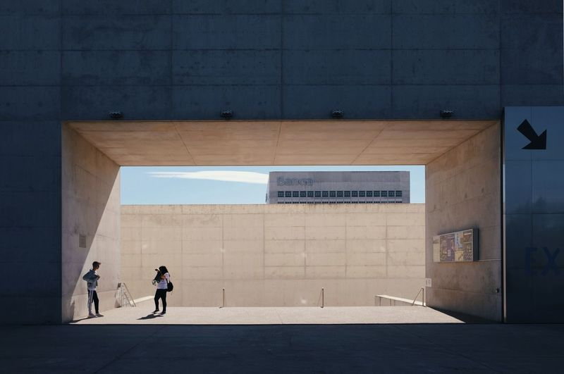 Roadtrip around Andalusia/Spain. 2nd Stop: Granada Architecture Communication Wall - Building Feature Full Length Built Structure Day People Sunlight Modern Streetphotography Street Photography Light And Shadow Shadows & Lights Architecture Architecture_collection Geometric Architecture Capture Tomorrow 17.62°