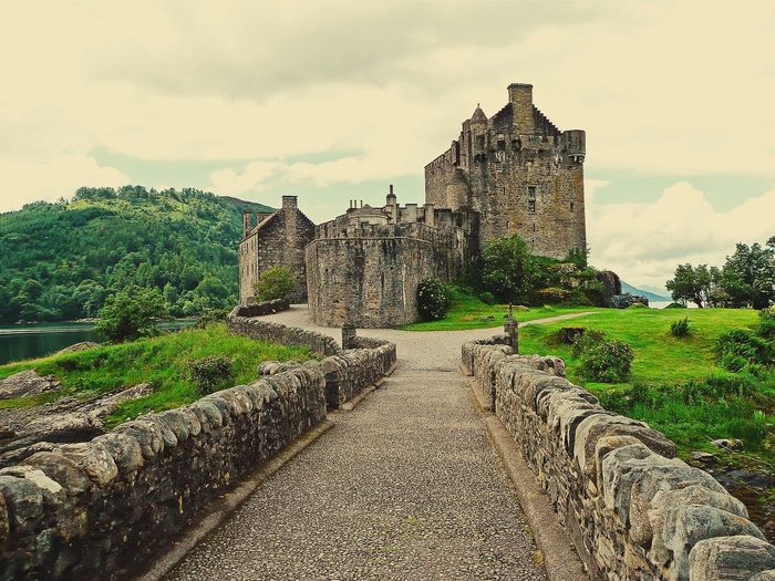 Footpath Leading Towards Eilean Donan Castle Against Cloudy Sky