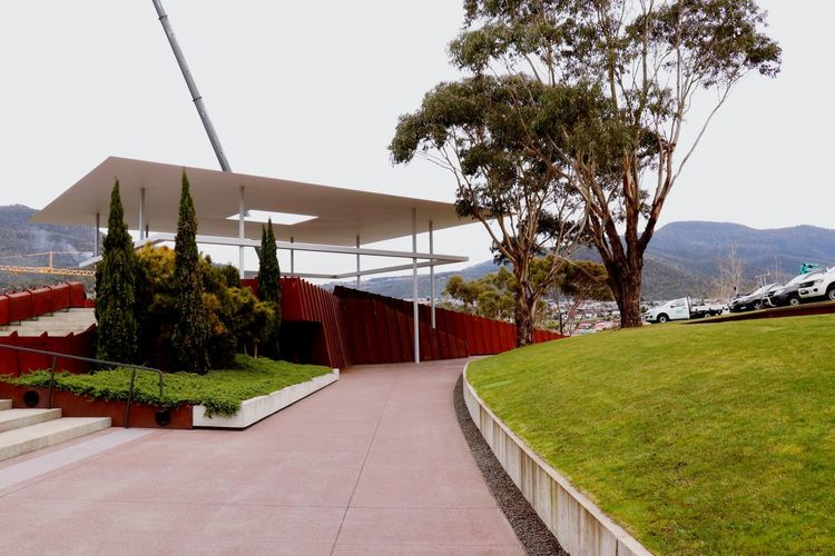 The entrance of MOMA at Tasmania. Architecture Architecture_collection Architecturelovers Museum Hobart Moma Architecturephotography Architecture Photography Day Outdoors Roof No People Mountain Nature