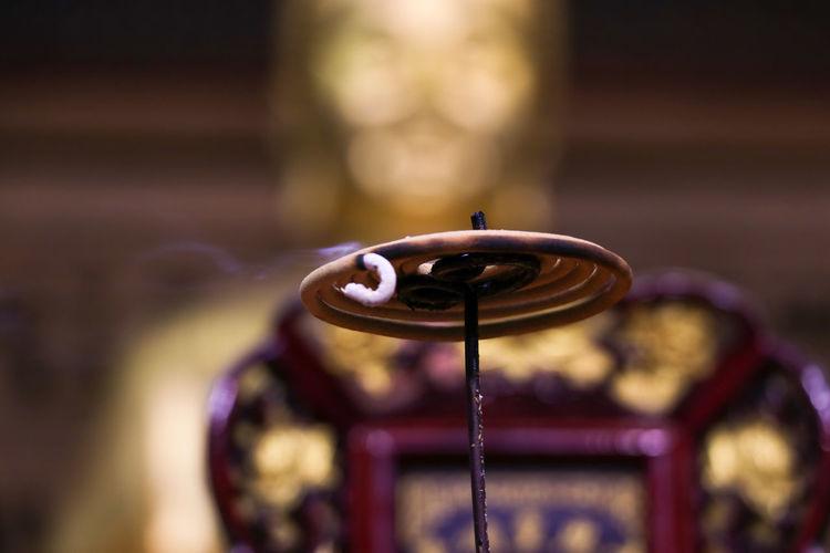 Close-up of illuminated incense