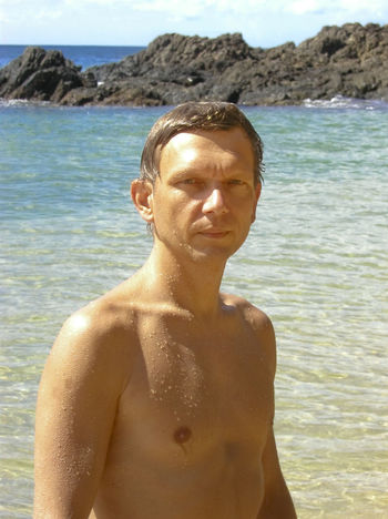 wet man in front of the caribbean sea - tobago, west indies 40s Athlete Beach Beach Life Beauty In Nature Caribbean Sea Caucasian Cliff Close-up Front View Happy Man Nature One Man Only Portrait Real People Sea Shirtless Summer Tobago Tropical Climate Vacations Waist Up Water Wet