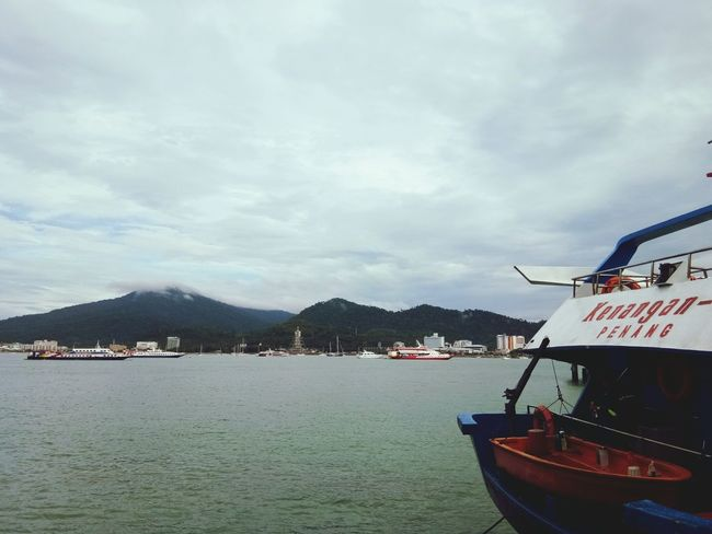 Nautical Vessel Water Transportation Moored Pedal Boat Outdoors Harbor Beauty In Nature Day No People Astrology Sign Mountain