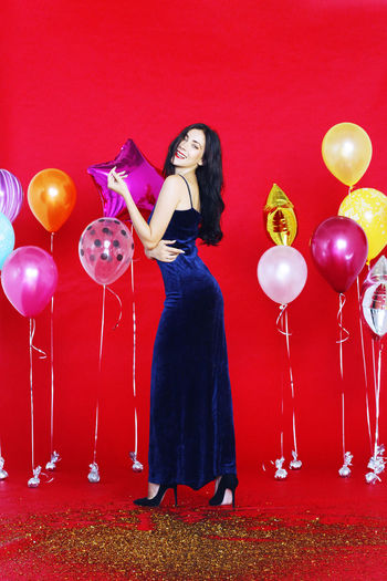 Full length of a woman with balloons