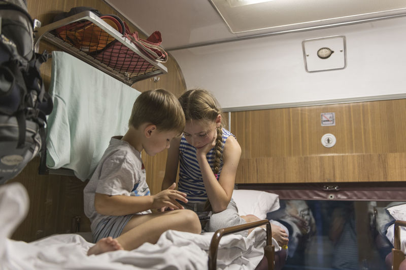 Russia Girl Boy Coach Corridor Coach Game Children Travel Train Pre-adolescent Child Family Girls Boys Bed Casual Clothing People Furniture Sitting Adult Bonding Females Lifestyles Indoors  Togetherness Childhood Child Women Two People Real People Indoors  Men Care