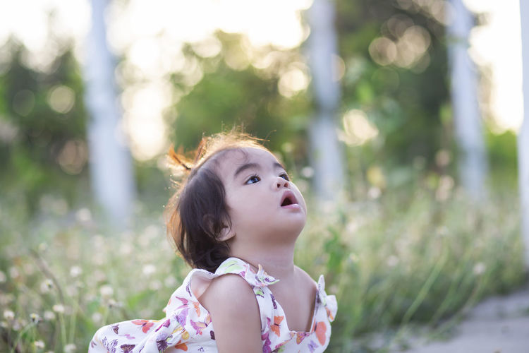 Portrait of cute girl looking away outdoors