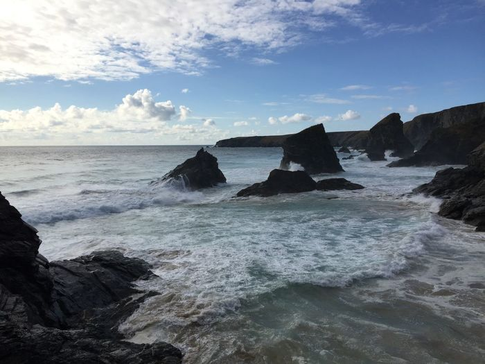 Beach Beauty In Nature Breaking Cloud - Sky Flowing Water Horizon Horizon Over Water Land Motion Nature No People Outdoors Power In Nature Rock Rock - Object Rock Formation Scenics - Nature Sea Sky Solid Sport Tranquil Scene Tranquility Water