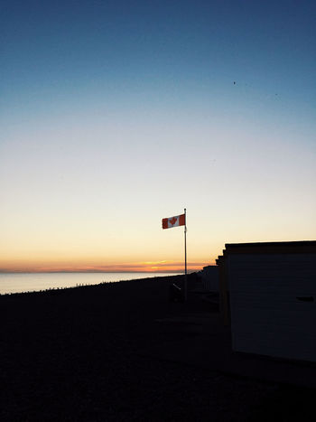 Worthing seaside Sun Sunset Gradient Sea Sea Life Seaside Sky Silhouette Nature Architecture No People Copy Space Built Structure Tranquility Beauty In Nature Tranquil Scene Scenics - Nature Building Exterior Sign Clear Sky Outdoors Dusk Road Orange Color Communication