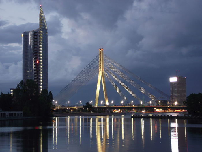 Architecture Bridge Bridge - Man Made Structure Building Exterior Built Structure City Cloud - Sky Connection Daugava Illuminated Nature No People Office Building Exterior Outdoors Reflection River Sky Tall - High Vansubridge Vanšu Tilts Vanšutilts Water Waterfront HUAWEI Photo Award: After Dark
