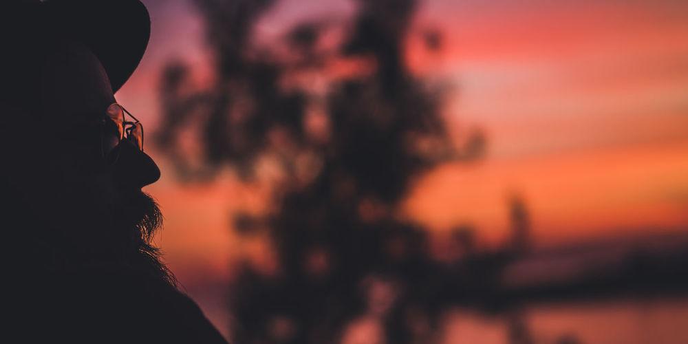 Man looking away at sunset