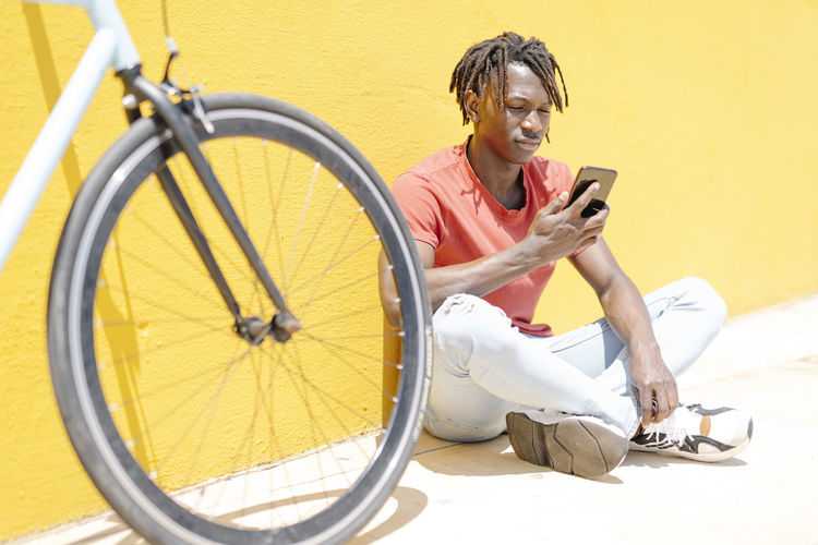 Side view of smiling man sitting on bicycle