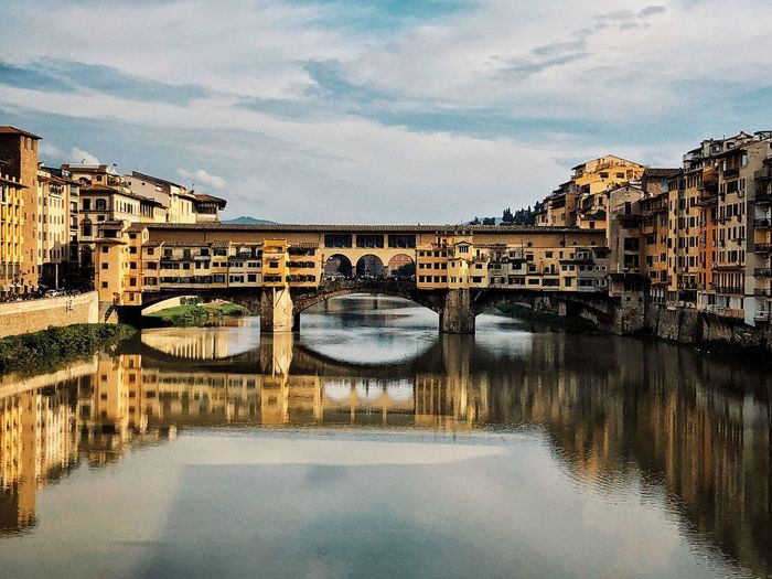 Ponte Vecchio Tuscany Medieval History Architecture Italy Florence Architecture Built Structure Water Bridge Bridge - Man Made Structure Connection Building Exterior Sky City Cloud - Sky River Reflection No People Arch Waterfront Outdoors Building Arch Bridge Day