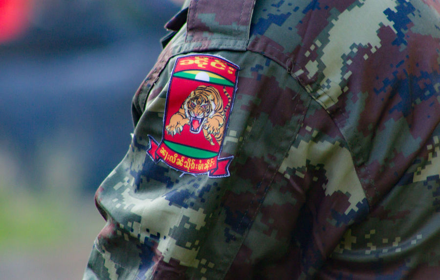 Unidentified A Soldier at Shan State in Myanmar Ssa Army EyeEmNewHere Armed Forces Badge Celebration Close-up Clothing Day Floral Pattern Focus On Foreground Government Military Military Uniform No People Outdoors Patriotism Pattern Selective Focus Textile Uniform