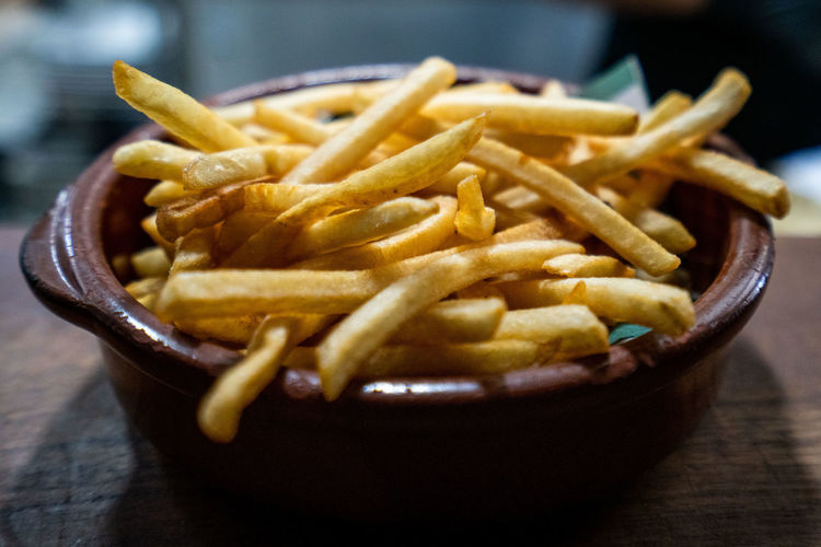 French Fries Potato Prepared Potato Ready-to-eat Food And Drink Table Food Unhealthy Eating Fried Fast Food Still Life Close-up Indoors  No People Freshness Serving Size Focus On Foreground Snack Deep Fried  Selective Focus Temptation Fast Food French Fries Comfort Food French Food