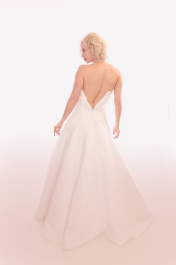 EyeEm Selects Women One Person Fashion Studio Shot Wedding Dress Clothing Newlywed Wedding Dress Bride Indoors  Beauty Full Length Standing White Background Blond Hair Young Women Beautiful Woman Celebration