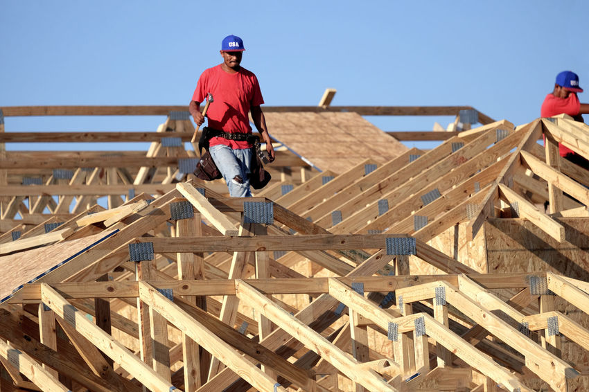 American Dream Blue Hat Building A House Carpenter Tools Carpenters Composite Image Construction Worker Florida Home Market Hammer Hard Worker Home Builder, Builder Of Dreams, Engineer's Life, Passion For Building. Lumber Lumber Industry Made In America Made In USA Man Holding Hammer Orlando Florida Real Estate Florida Red Shirt Roof Top View  Roofer Tool Belt USA Hat Walking On Roofs Wood Frame