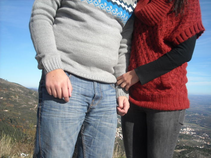 Midsection of couple wearing warm clothing