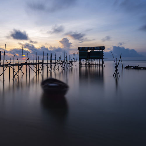 Dawn of fishing village of Bintan Island, Indonesia Bintan  Blue Hour Fishing Village INDONESIA Kelong Silhouette Beauty In Nature Cloud - Sky House Over The Sea Lifestyles Long Exposure Nature No People Outdoors Peaceful Morning Scenics - Nature Sea Sky Sunrise Sunset Tranquil Scene Tranquility Water Waterfront Wooden House